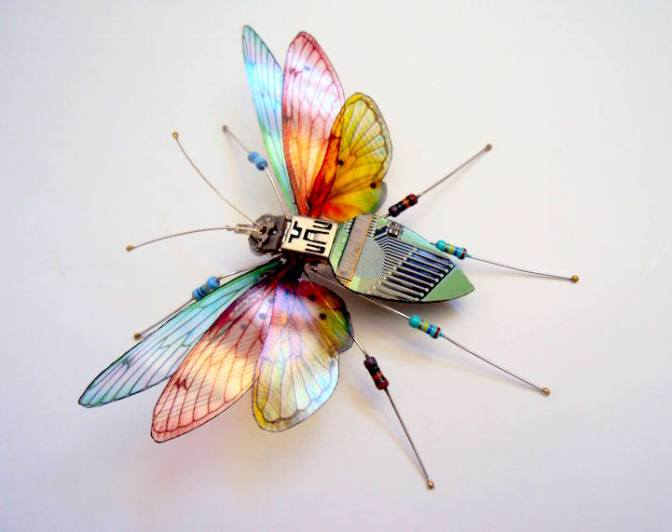 Miniature winged insects made from discarded circuit boards.