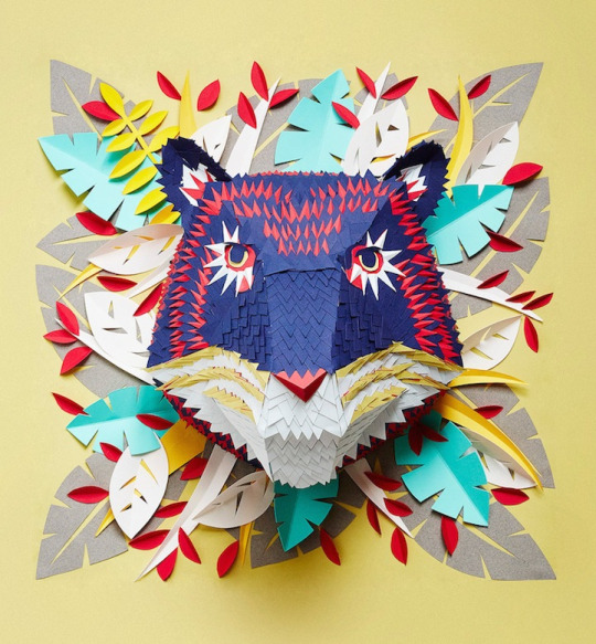 Delicate artistic paper masks of animal faces full of colours and beauty