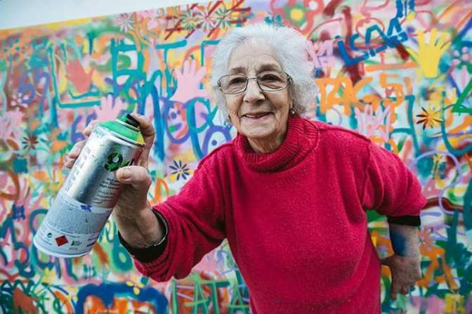 An architect teaching senior citizens how to do street art
